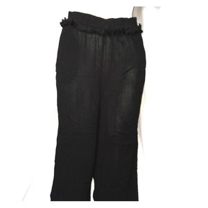 Top shop black capris with tassel accents